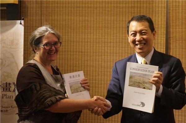 Dr. Tamsin Kerr (left) holds up a Chinese copy of