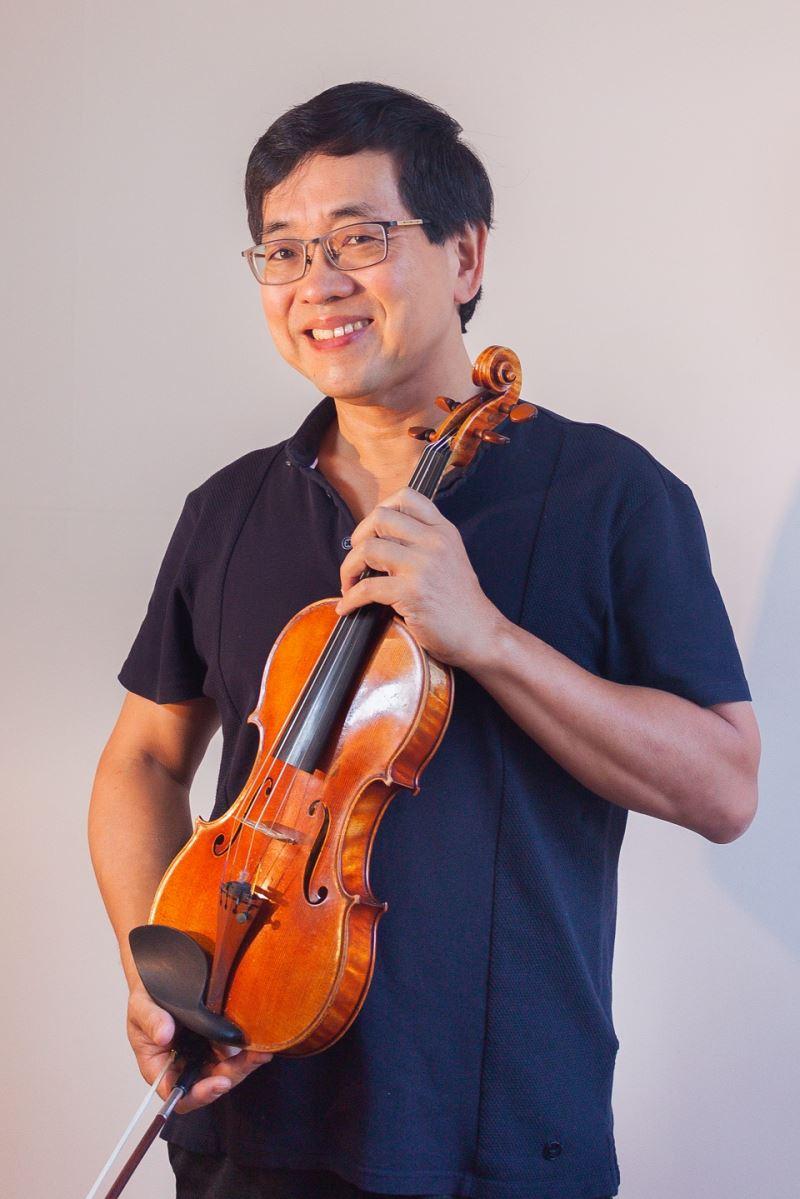 旅美小提琴家兼指揮家_辛明峰