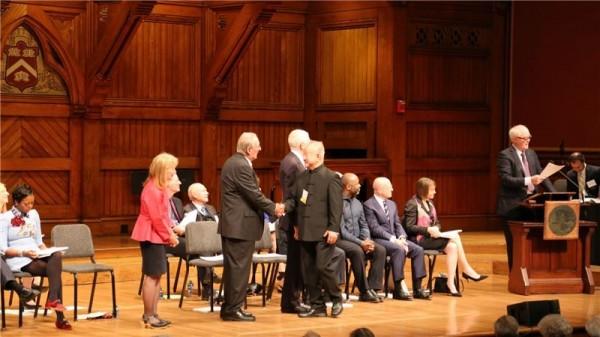 Liu shakes the hands of Academy President Jonathan F. Fanton.