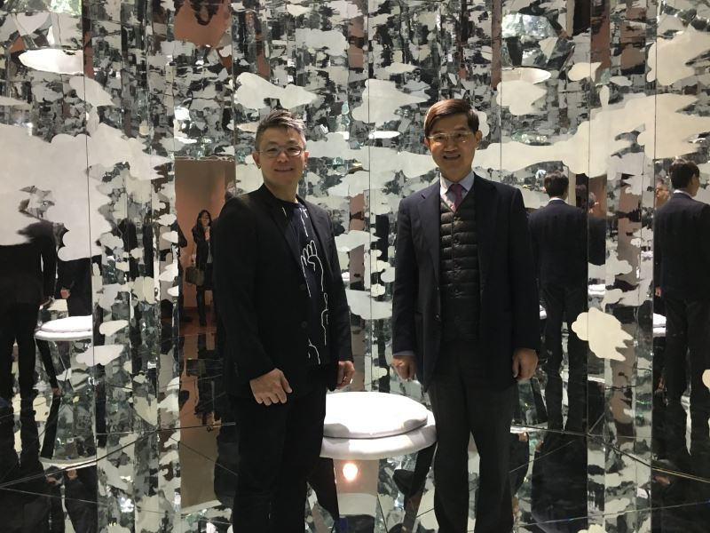 Nick Dong (left) and Amb. Abraham Chu standing within the installation