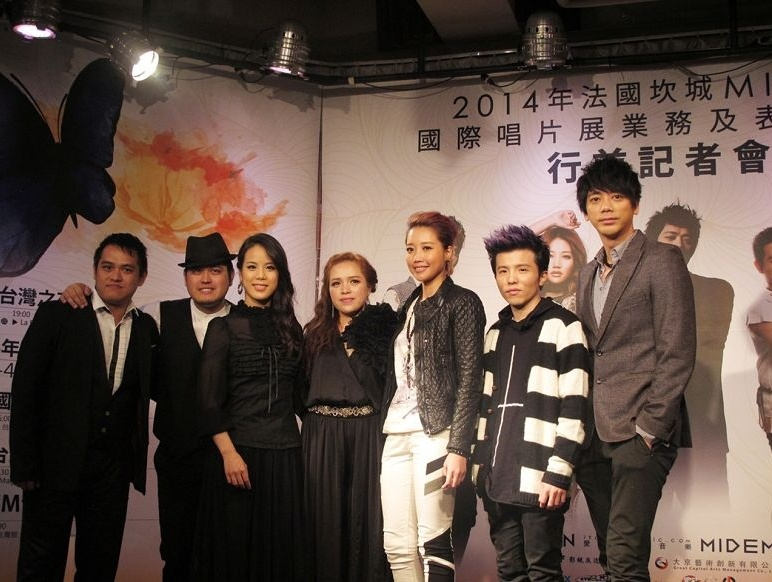 From left to right: A cappella band O-Kai Singers (all in black), pop diva A-Lin (pink hair), singer-songwriter Xiao Yu (purple hair), and rock star Shin (suit).