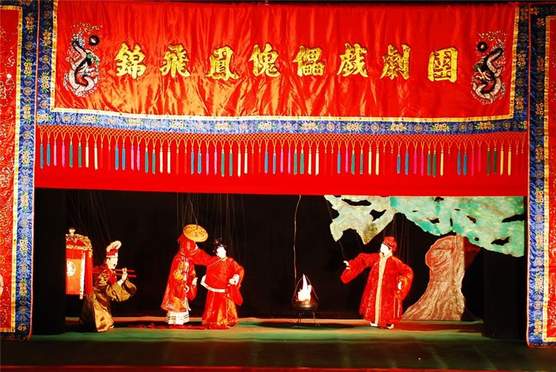 "A scene in "" Peach Blossom Fairy Fighting Daoist Zhou ""(2009)."