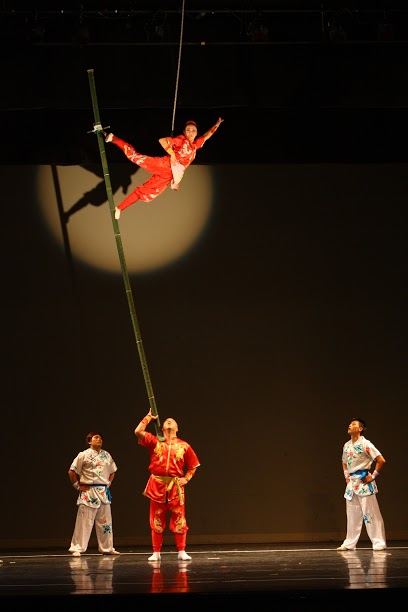 "A scene from the performance of "" Bamboo Pole Acrobatics"" ."