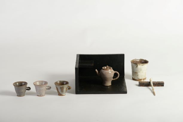"""Tsung-Ju LI  """"The Beauty of Rustic II"""" ceramics wheel-thrown, slab-built, hand-built tea pot: 9×6×8 cm tea serving pot:  Ø 7×8 cm tea scoop holder: 10×2×1.5 cm tea cup (3 pieces): Ø5×6 cm screen: 24×24×25 cm tea scoop: 18×2×1 cm    Not in pursuit for perfection! Nor for producing publicity by keeping in low profile! The kind of pottery that has moved along with time would eventually give birth to natural rustic beauty. It is closer to human hearts and making people around more at ease."""