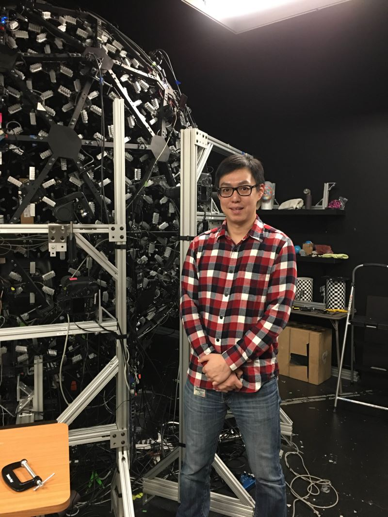 Taiwan software engineer Ma Wan-chun stands next to the dome-like Light Stage X.