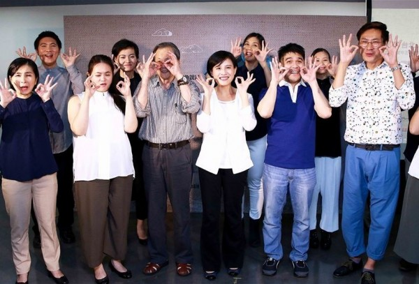 Culture Minister Cheng Li-chiun (front center, in white) poses with the hand gesture for