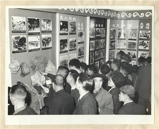People visiting an exhibition depicting the