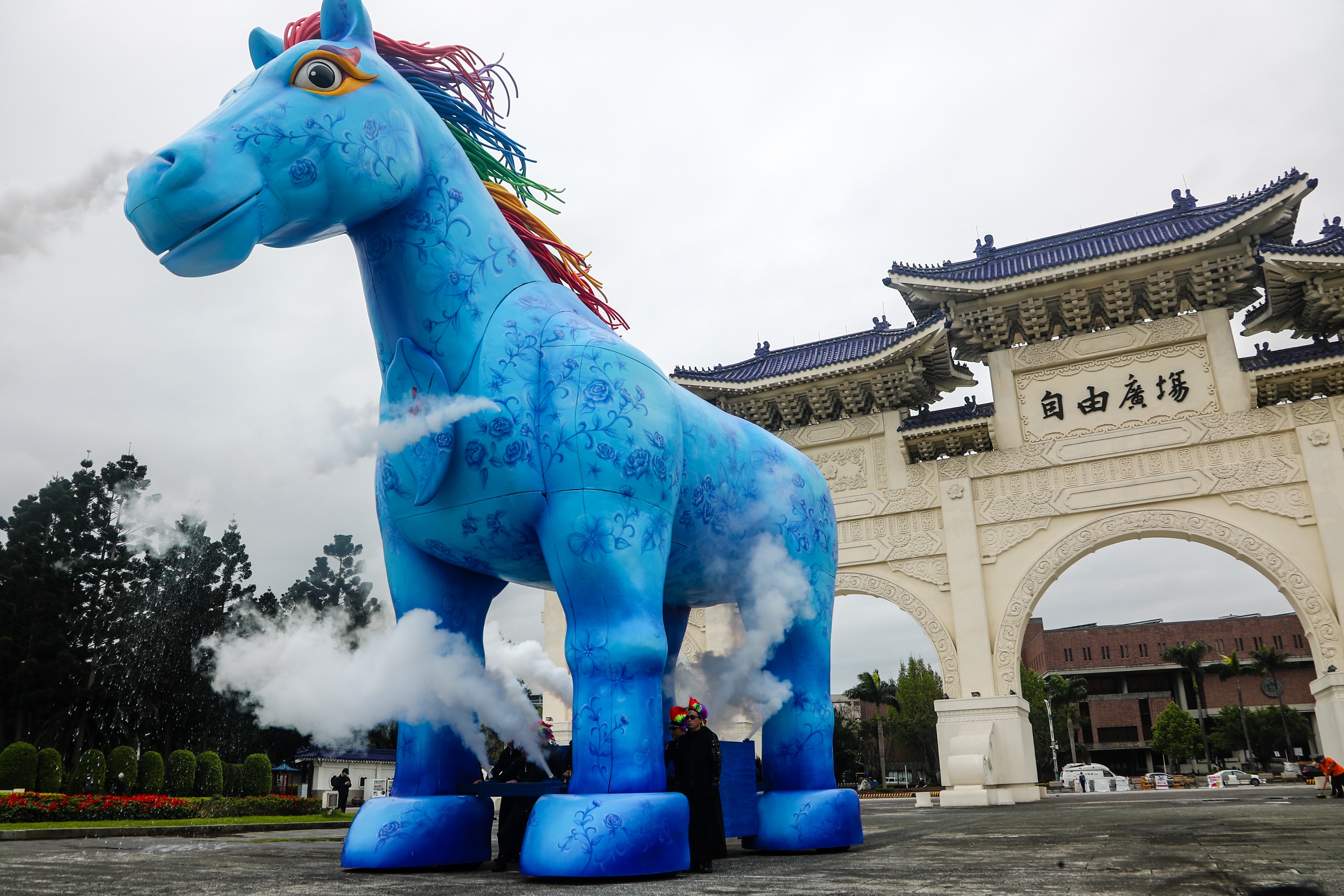 Paper Windmill Theatre exhibits giant blue horse statue in front of Sun Yat-sen Memorial Hall